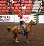 Calf Roping Official On Horseback Royalty Free Stock Photos