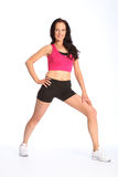 Calf stretch exercise by beautiful fit woman Royalty Free Stock Photography