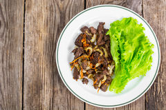 Calfs liver with letucce garnish Royalty Free Stock Photography