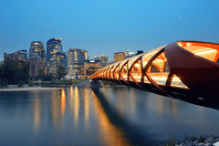 Calgary. Cityscape with Peace Bridge and downtown skyscrapers in Alberta at dusk, Canada Stock Photo