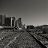 Calgary Cityscape viewed from Train Tracks. Black and white Calgary cityscape viewed from train tracks Royalty Free Stock Images