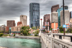 Calgary Downtown in HDR. HDR rendering of Calgary downtown showing Lions Gate Bridge across the Bow River and surrounding skyscrapers royalty free stock images