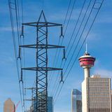 Calgary Electricity Cityscape. Cityscape of Calgary, Alberta, Canada with a high voltage power line Stock Images