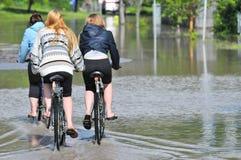 2013 Calgary Flood Girls Biking Royalty Free Stock Image