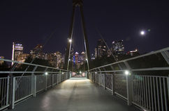 Calgary at Night. Calgary Skyline with Eau Claire Pedestrian Bridge in Foreground Stock Image
