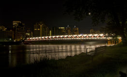 Calgary Peace Bridge. Peace Bridge in Calgary, Alberta at Night. The  pedestrian and cycling bridge carries more than 5000 people across the Bow River a day in Stock Image