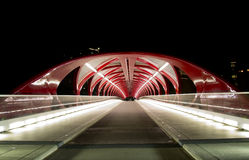 Calgary Peace Bridge. Peace Bridge in Calgary, Alberta at Night. The  pedestrian and cycling bridge carries more than 5000 people across the Bow River a day in Royalty Free Stock Images
