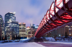 Calgary's Peace Bridge and skyline at night Stock Photography