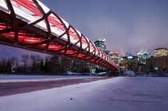 Calgary's Peace Bridge and skyline at night Stock Photos