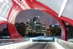 Calgary's Peace Bridge and skyline at night Stock Image