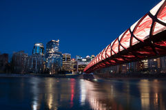 Calgary's Peace Bridge and skyline at night Stock Photos