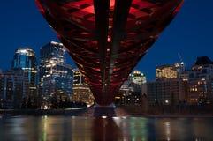 Calgary's Peace Bridge and skyline at night Royalty Free Stock Photography