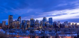 Calgary skyline at night with Bow River Royalty Free Stock Photos