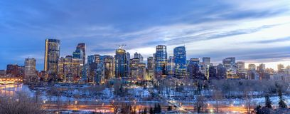 Calgary skyline at night with Bow River Royalty Free Stock Photo