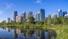 Calgary skyline reflected in a wetland. Calgary skyline reflected in a reconstructed urban wetland along the Bow River Stock Photo