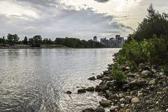 Calgary skyline seen from Bow River. Calgary skyline seen from the Bow River banks Royalty Free Stock Photo