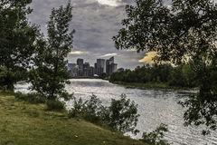 Calgary skyline seen from Bow River. At Prince`s Island Park royalty free stock photos