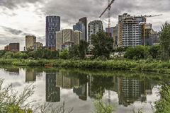 Calgary skyline seen from Bow River. At Prince`s Island Parks royalty free stock images