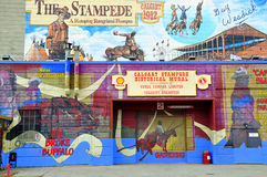 Calgary Stampede mural. Calgary: A mural on the site of the Calgary Stampede depicting some of the history of the legendary event and rodeo Stock Image