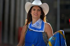 Calgary Stampede Parade - Greatest Outdoor Show on Earth , Calgary ,Alberta , Canada . Calgary Stampede parade staff member posing and looking at spectators Stock Image