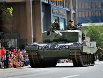 Calgary Stampede Parade 2014 -greatest outdoor show on earth. A canadian army tank parading . two canadian soldiers greeting the spectators Stock Image