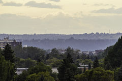 Calgary suburbs seen from Bow River. At Prince`s Island Park royalty free stock photos
