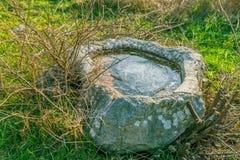 Calha antiga da água no campo Fotos de Stock Royalty Free