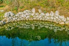 Calha antiga da água no campo Fotografia de Stock