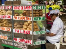 Female street vendor of different types of traditional breads in Cali stock photo