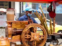 Street seller of cane juice called guarapo royalty free stock image