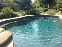 Cali pool. A photo of a pool in Cali with a pretty garden Royalty Free Stock Photos
