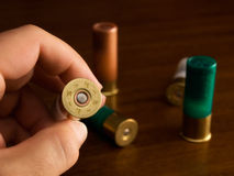 Caliber. Hunter shows the caliber of  hunting cartridges Royalty Free Stock Photo