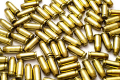 .40 Caliber Bullets on White Stock Photos