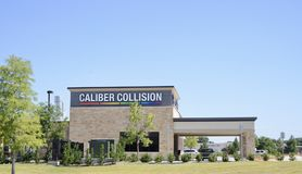 Caliber Collision Center, Lewisville, Texas. Caliber Collision Repair Center located in Lewisville, TX, is a body shop and automobile collision repair shop where royalty free stock image