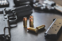 .45 Caliber hollow point bullets near handgun and magazine Royalty Free Stock Photography