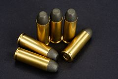 The .45 caliber revolver cartridges on black. Background Stock Photo