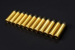 The .45 caliber revolver cartridges on black. Background Royalty Free Stock Photography