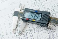 Calibrador de Digitaces en el papel de espec. del gráfico Imagen de archivo