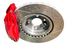 Calibrador rojo auto montado de los frenos de disco con los cojines Imagen de archivo libre de regalías