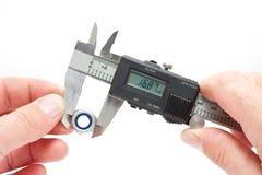 Calibrador a vernier de Digitaces del equipo de medida fotografía de archivo