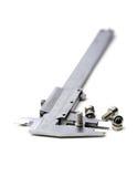 Calibrador y tornillos Imagen de archivo libre de regalías