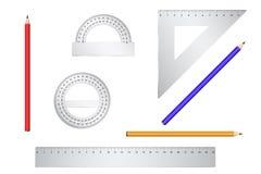 Calibradores de la escuela y lápiz tres en un backgrou blanco Imagen de archivo