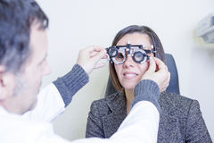 Calibrating the eye test glasses phoropter Stock Photos