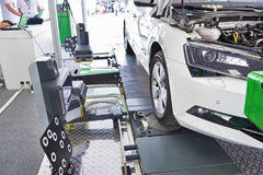 Calibration of camera on lane at road in car workshop Stock Photo