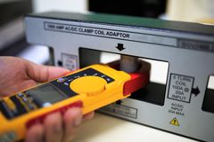 Calibration clamp meter with clamp coil adaptor Royalty Free Stock Images