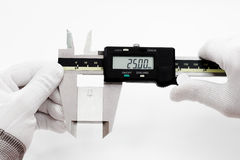 Calibration digital VERNIER with gage block. Calibration Vernier caliper with gage block stock image