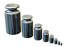 Calibration Masses - Graduated. Accurate stainless steel weights for calibrating laboratory scales Royalty Free Stock Images