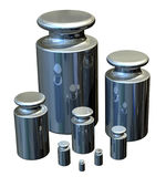 Calibration Masses - Stainless Steel. Accurate stainless steel weights for calibrating laboratory scales Royalty Free Stock Photography