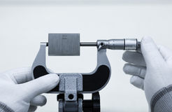 Calibration outside micrometer on micrometer clamp Royalty Free Stock Photos
