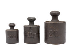 Calibration weights. Ancient calibration weights isolated on a white background stock photography